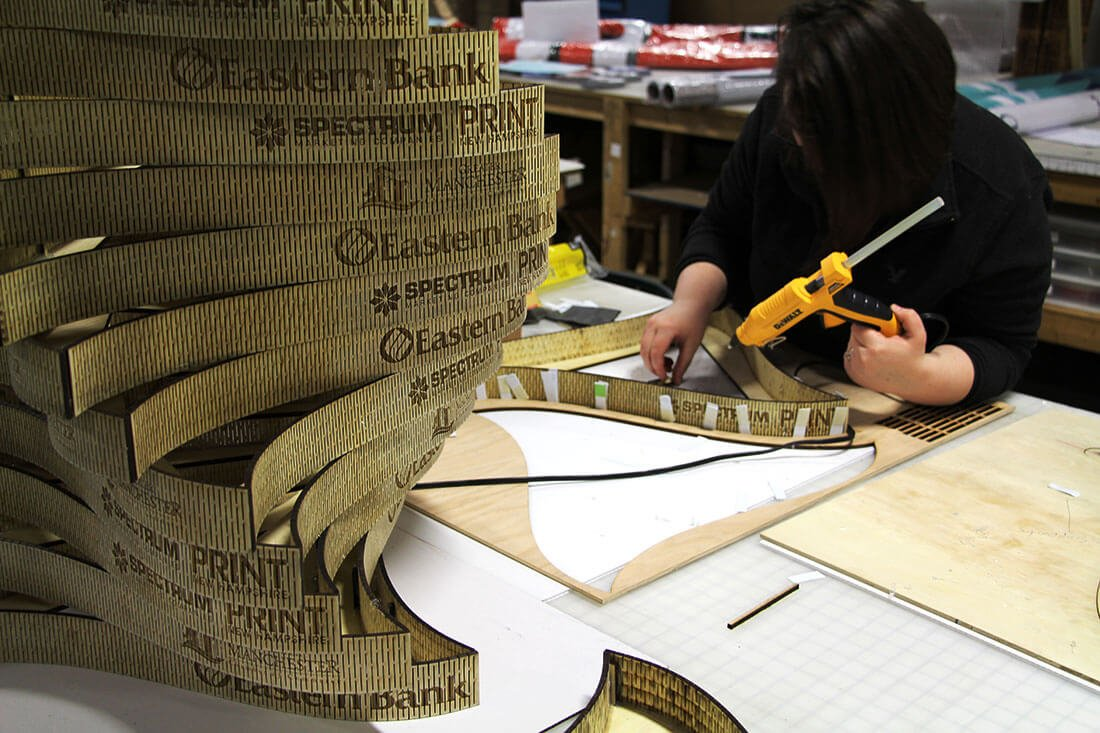 Greater Manchester Chamber of Commerce Citizen of the Year center piece assembly glueing pieces