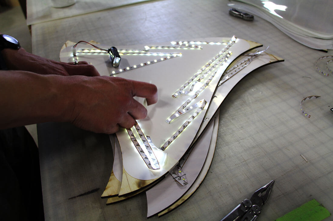 Greater Manchester Chamber of Commerce Citizen of the Year center piece assembly attaching LEDs