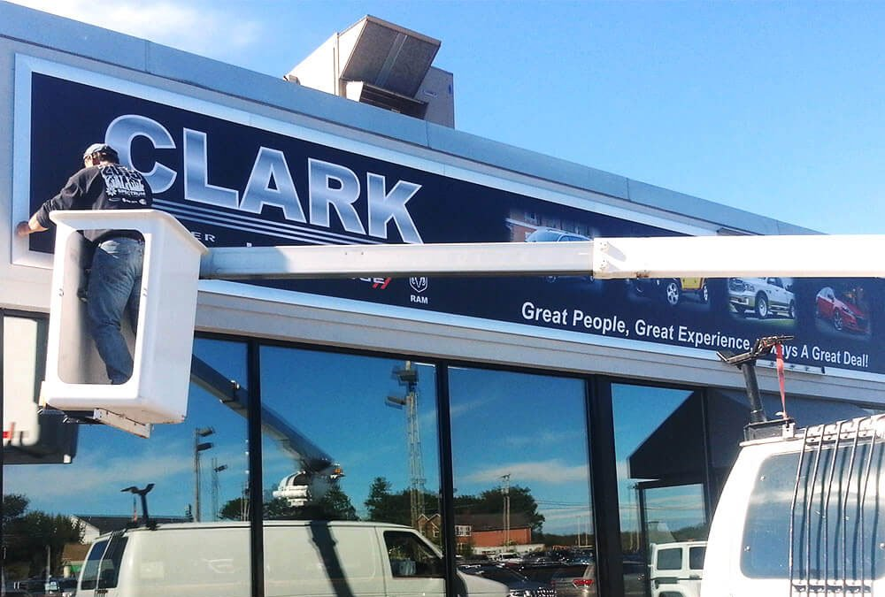 exterior sign installation - Clark Motors