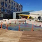 Clark Avenue School in Chelsea, MA entry plaza concrete earth architectural graphics