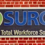 finished surge textured sign on brick wall