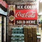 large coke and brick wall wrap