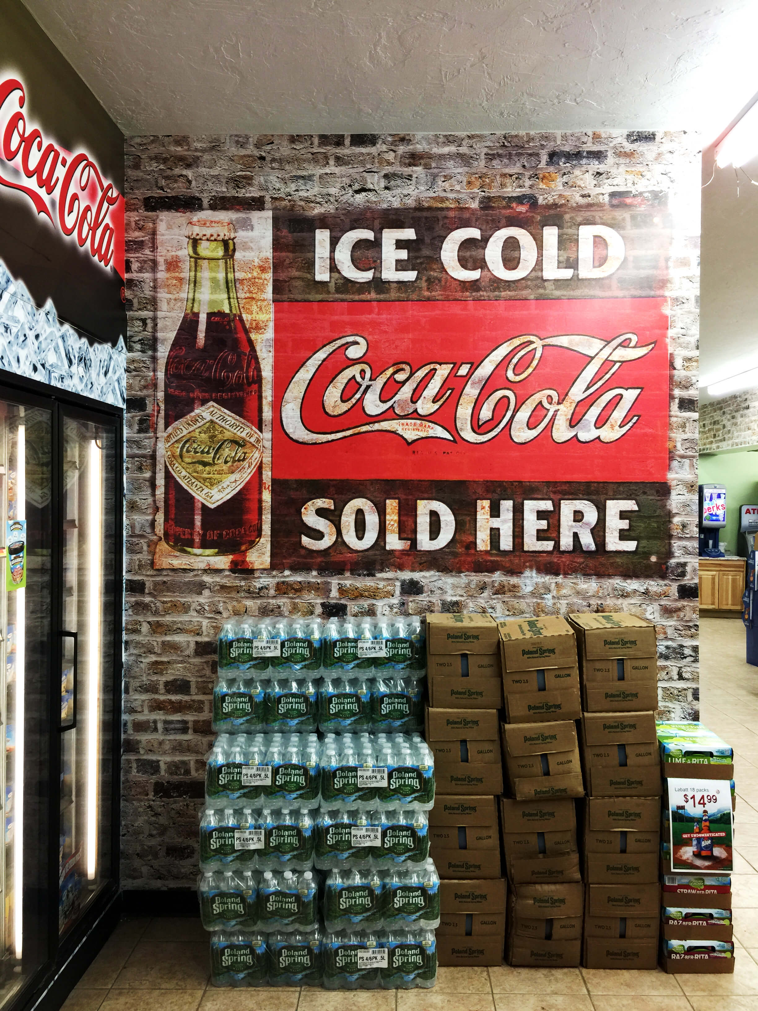 large coke and brick wall wrap