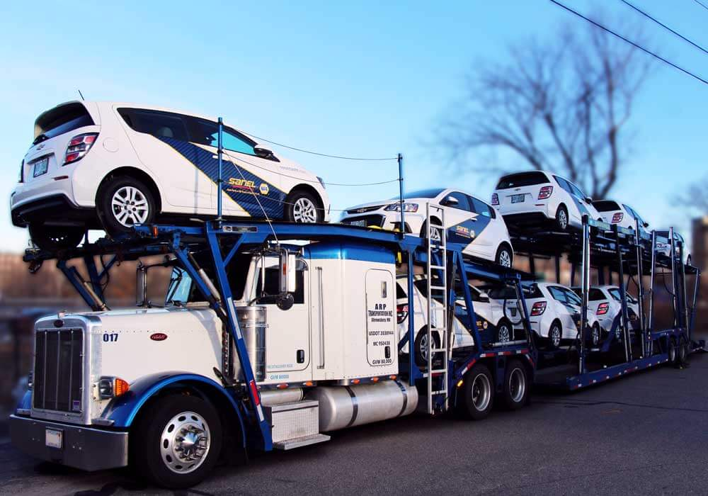 Sanel NAPA car fleet on transport truck