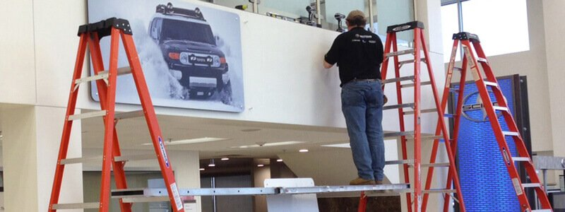 sign installer at auto dealership